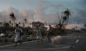 TOPSHOTS Typhoon victims walk along a ro