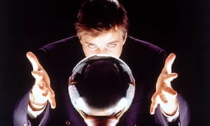 Businessman staring into a crystal ball crystal