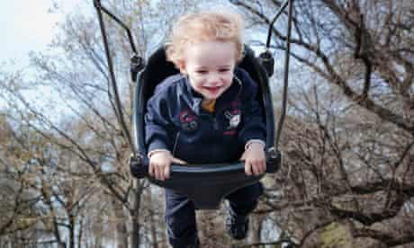 Toddler in swing