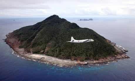 A Japanese patrol plane flies over the disputed Senkaku islands in the East China Sea
