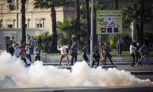 Egyptian protesters near a cloud of teargas in Cairo