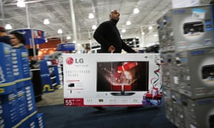 A shopper carries away a discounted television from a Best Buy store