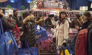 Shoppers queue at Toys 'R' Us in Times Square.