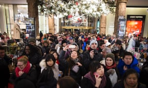 A shopper takes a selfie as crowds pour into Macy's flagship store inHerald Square, New York City.