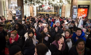 A shopper takes a selfie as crowds pour into the Macy's Herald Square flagship store, Thursday, Nov. 28, 2013, in New York.
