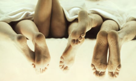 bed feet - end of monogamy piece in Review - four people - sexual activity - lying down - duvet -  bd3530-001 Credit: Stone/Getty Creative