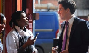 Ed Miliband talking to a shop worker