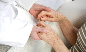 Palliative care: a therapist holds a client's hands