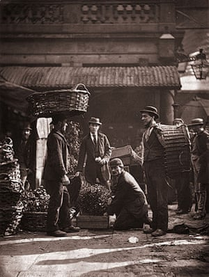 Street Life in London: Porters with boxes of plants at Covent Garden market