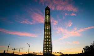 The sunrises behind the scaffolding clad Washington Monument in Washington. The National Park Service has announced the decorative lighting will be turned off as work crews begin the task of removing the scaffolding from around the earthquaked damage monument.