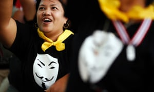 Protesters wearing Guy Fawkes t-shirts cheer during a rally against the amnesty bill in central Bangkok.