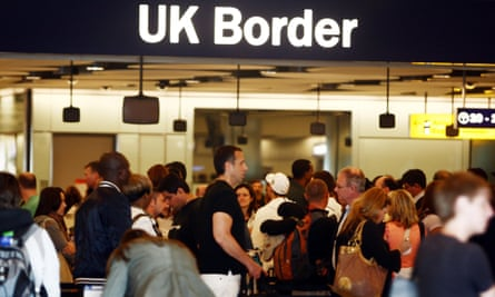 People queue for border checks at Heathrow airport