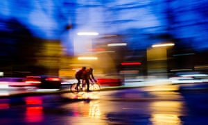 Two cyclists in the rain in Hanover, Germany.