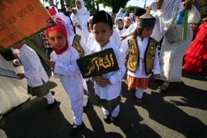 Children attend a parade to celebrate the Islamic new year in Banda Aceh, Indonesia.