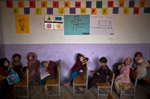 Afghan refugee schoolchildren attend a class in a makeshift school on the outskirts of Islamabad, Pakistan.