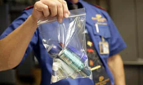 A security officer shows a plastic bag