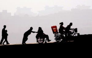 People are photographed in silhouette near West Lake in Hangzhou, China.