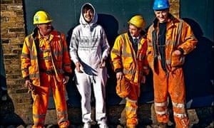 Man in onesie with workmen