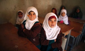 Girls attend a class at their primary school in a village in the Sana'a,Yemen