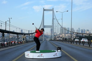 Tiger Woods makes history as he hits the first golf shots from east to west on Istanbul's Bosphorous Bridge, linking Asia and Europe in Istanbul, Turkey.