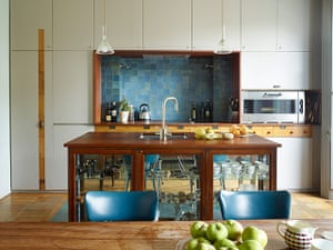 Homes - In With The Old: kitchen area with blue chairs and white cupboards