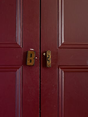 Homes - In With The Old: printers' blocks on red coloured doors