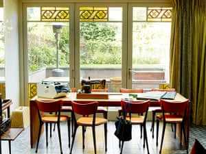 Homes - In With The Old: Dining area with orange chairs
