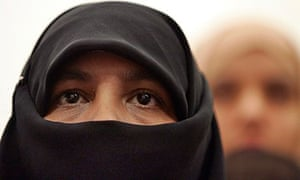A Muslim woman wearing a niqab