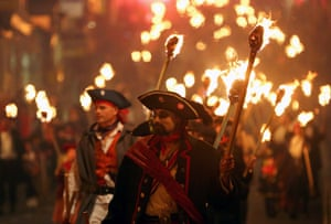 The Lewes Bonfire Society's parade through Lewes, in East Sussex, as part of their bonfire night celebrations.