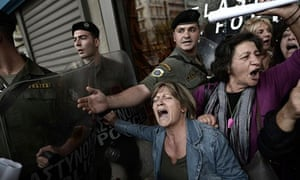 Greek protesters are pushed back as EU and IMF officials leave the Greek finance ministry