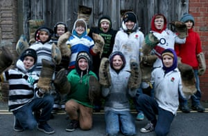 Barrel boys: Junior tar barrel participants pose for a photograph prior to carrying burning tar barrells in Ottery St Mary, Devon, England. The event - which is over 400-years-old, sees competitors running with burning barrels on their back through the village, until the heat becomes too unbearable or the barrel breaks down - starts with junior barrels carried by children and continues all evening with ever larger and larger barrels