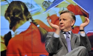 Michael Gove applauding at conference