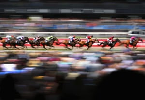 The field goes along the straight during race 3 the Carnival Handicap during Melbourne Cup Day at Flemington Racecourse in Melbourne, Australia.
