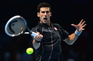 Novak Djokovic of Serbia hits a forehand in his men's singles match against Roger Federer of Switzerland during day two of the Barclays ATP World Tour Finals at O2 Arena in London, England.