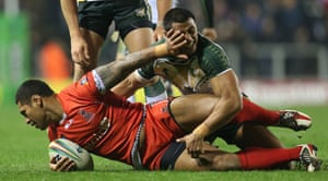 Tonga's Maha Fonua and Cook Island's Daniel Fepuleai (left) wrestle for the ball during the 2013 World Cup match at Leigh Sports Village, Leigh, England.