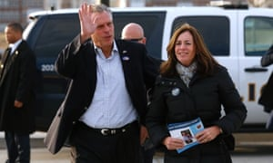 Virginia Democrat gubernatorial candidate Terry McAuliffe waves as he and his wife Dorothy arrive to campaign outside a metro station on election day in Fairfax, Virginia.,