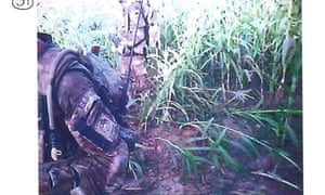 Still image from a video recorded during the shooting of an injured Afghan insurgent