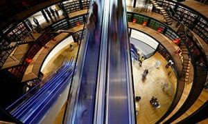 Visitors travel on an escalator after the opening of Birmingham Library in central England