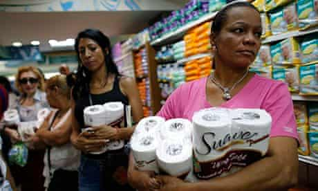 Women buy toilet paper at a supermarket in Caracas