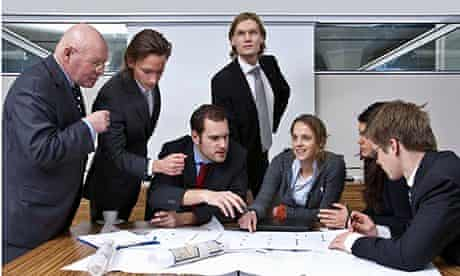 people in board room with papers