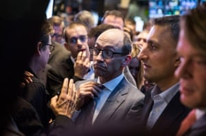 Twitter CEO Dick Costolo adjusts his tie while waiting to see what Twitter's opening market price will be on the floor of the New York Stock Exchange.