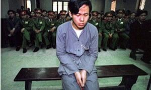 A Vietnamese teenager faces a firing squad