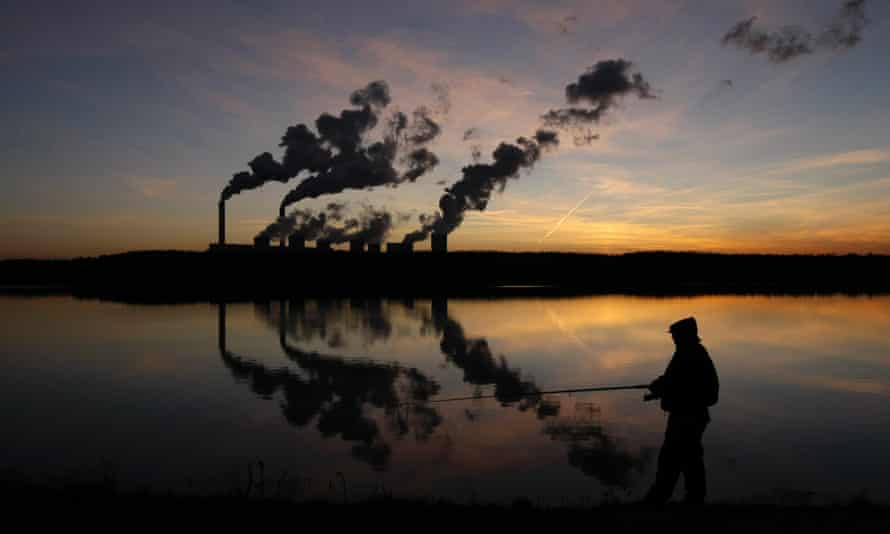 A man fishes in an artificial lake outside Belchatow Power Station, Europe's largest coal-fired power plant.