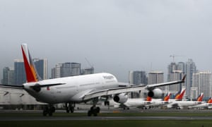 A Philippine Airlines plane lands at Manila's international airport, Philippines, 08 November 2013. The civil aviation authority said 12 airports had closed