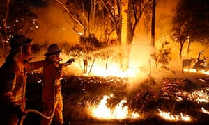 Firefighters attempt to extinguish a bushfire at the Windsor Downs Nature Reserve, near Sydney