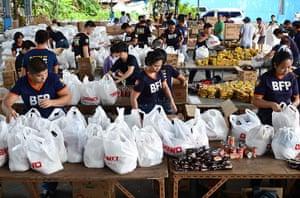 Typhoon Aftermath: Volunteers pack relief goods