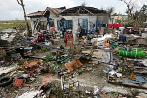 Typhoon Aftermath: A Filipino boy stands among the debris