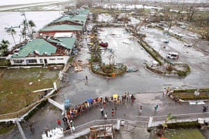 Typhoon Aftermath: Residents wait for relief goods