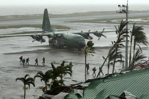 Typhoon Aftermath: Filipino soldiers disembark at the airport