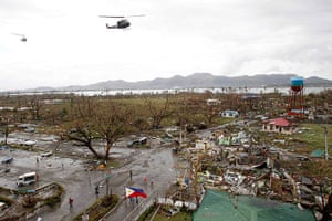 Typhoon Aftermath: Helicopters hover over the damaged area